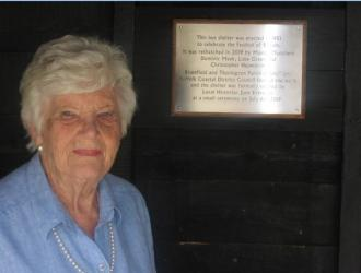 June Brereton admires the plaque