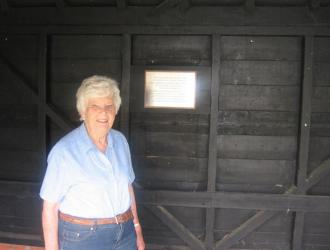 Local historian June Brereton admires the plaque in its final position
